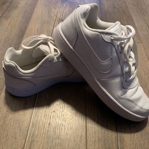 All white leather Nike sneakers